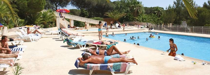 Families Relaxing By the Swimming Pool at the Pins Parasols Campsite, France
