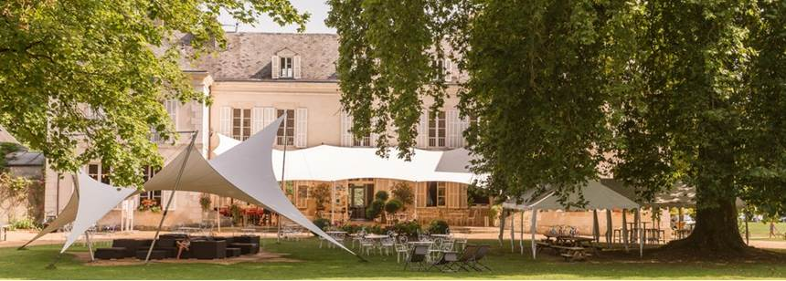 Relaxing lawn seating outside reception at Château de Chanteloup, near Le Mans, Sarthe, France