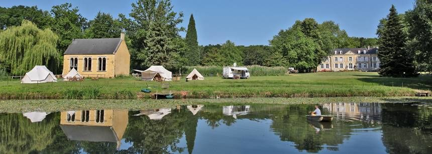 Views of Grass Pitches and the Château at the Château De Chanteloup Campsite, France
