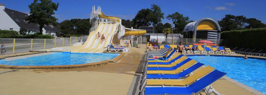 Waterslides and pool terrace at Camping Le Moustoir, Carnac, France