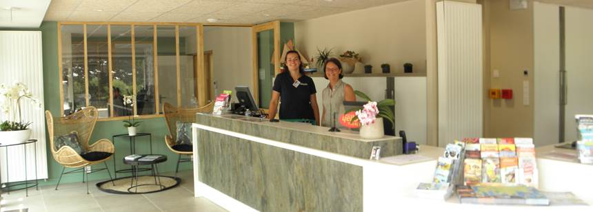 Friendly reception staff at Camping Mané Guernehué, Brittany, France
