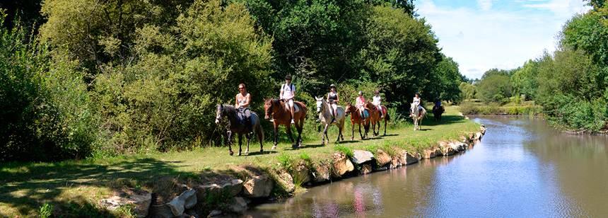 Horseriding by the river, near Mané Guernehué campsite, near Carnac, South Brittany, France