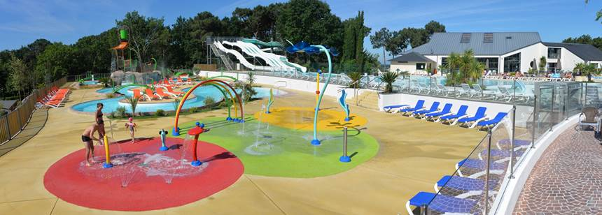 Fun at the splash pad and aquapark at Mané-Guernehué campsite, near the Golfe du Morbihan and Carnac in southern Brittany