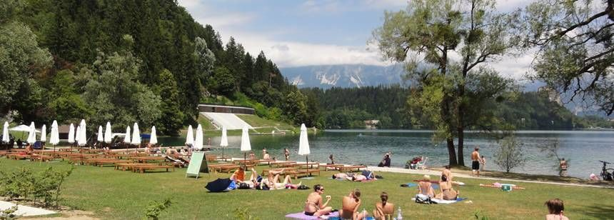 Families Relaxing Beside the Lake at the Bled Campsite, Slovenia