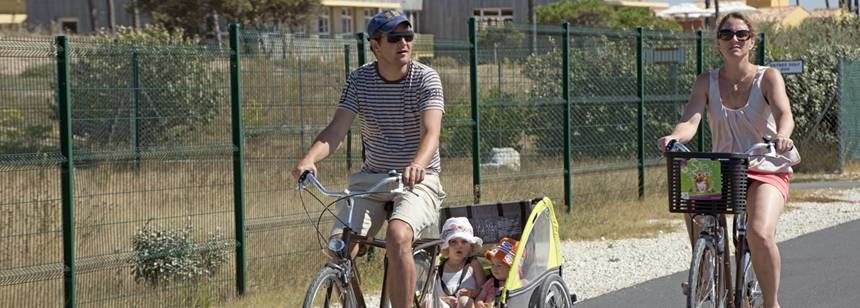 Families Cycling Through the The Cote De La Beauté Campsite, France
