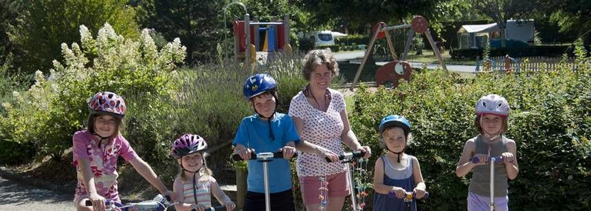 Families Cycling Through the The Lou P'Tit Poun Campsite, France