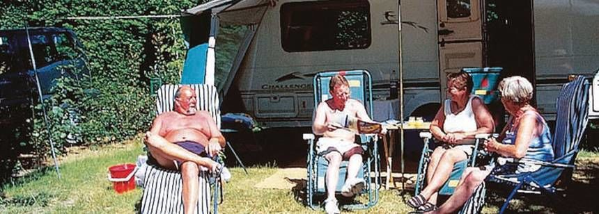 Relaxing By Their Motorhome at the Le Bois Joli Campsite, France