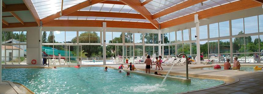 Indoor pools with accessible ramp at Camping Les Amiaux, St. Jean-de-Monts, Vendée, France