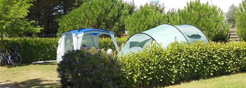 Grassy pitches at Camping La Corniche, Brittany, France