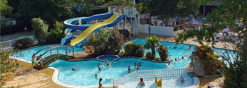 Waterslides and pool area at Camping La Piscine, Beg-Meil, France