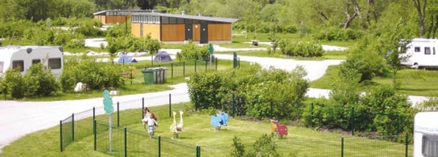 Grass Pitches and Childrens Play Area at the Parc Des Cygnes Campsite, France