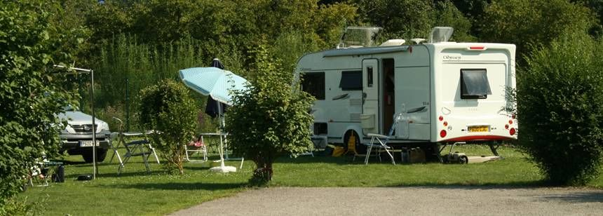 Shaded Grass Pitches at the at the Parc Des Cygnes Campsite, France