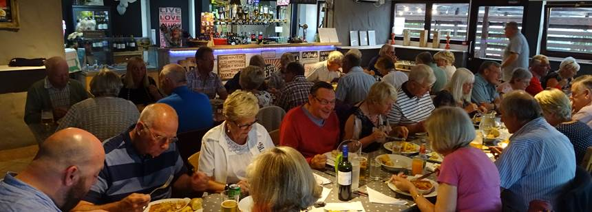 Ralliers enjoying a meal at the site restaurant on the Beuvelande Rally campsite, Jersey, Channel Islands