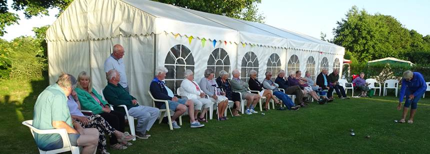 Boules competition outside the marquee on the Beuvelande Rally campsite, Jersey, Channel Islands
