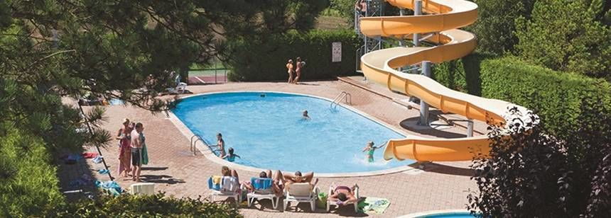 The outdoor pools and waterslide at Beauregard campsite, Mesnois, France
