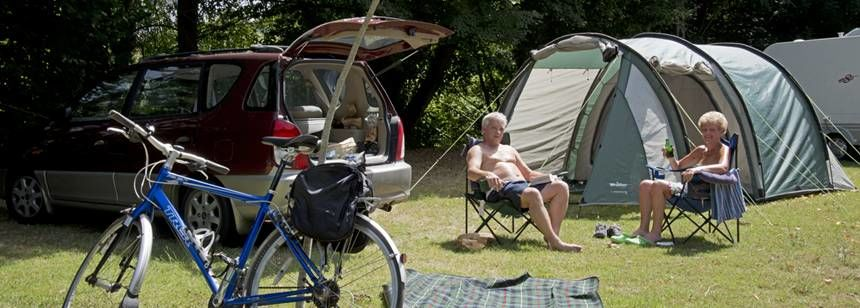 Relaxing Beside Tent at the Beauregard Rally , Campsite France