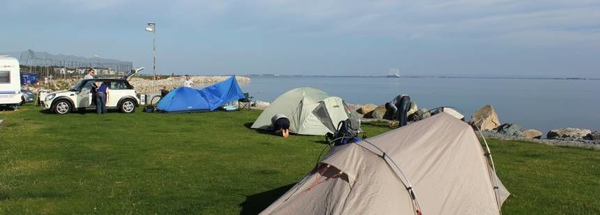 Tents pitched by the water at Salthill Caravan Park, Galway