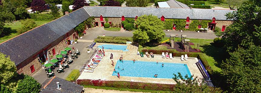 The pretty courtyard and pool area at Domaine du Logis, Brittany, France