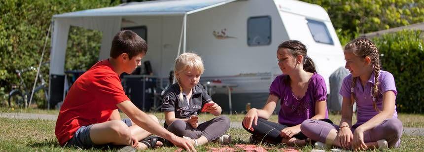 Children enjoying a game at Domaine du Logis