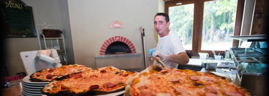 Enjoy a pizza at Camping Orlando in Chianti, Tuscany, Italy