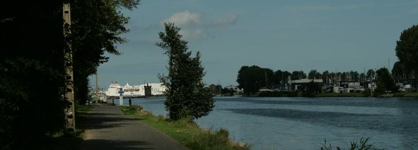 The ferry port is 1.5 miles, along the canal tow path, from Camping Riva Bella, Ouistreham, France