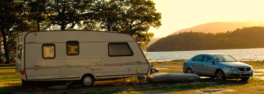 Caravan pitched up on the shores of Loch Lomond at Cashel Campsite