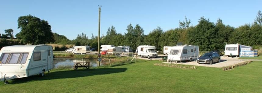Caravans sited around pond at Carsington Fields