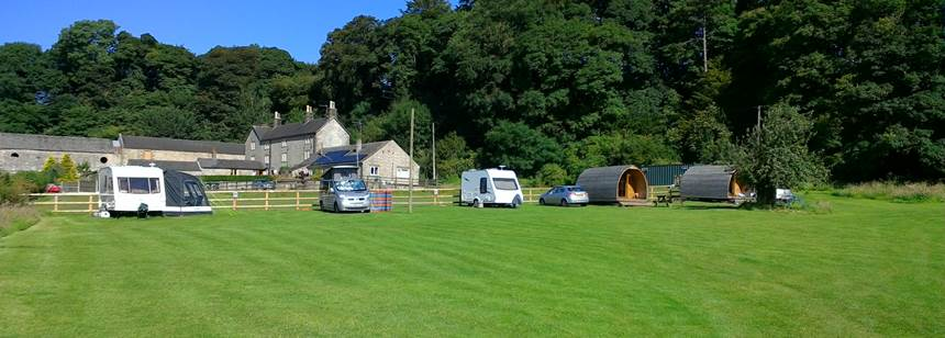 Caravans on the hills at Ballidon Moor Farm.