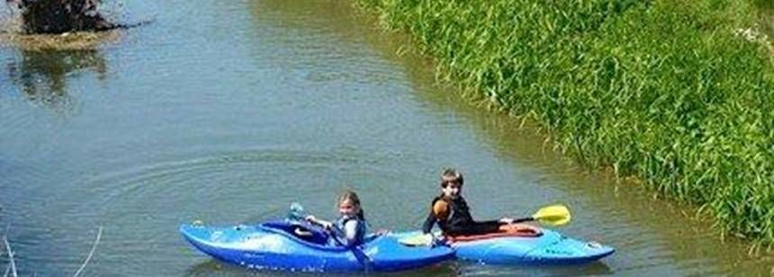 Guests from the Watersmeet Farm site take to the water in canoes