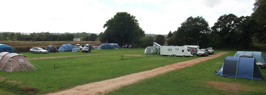 View of campsite with caravans and tents