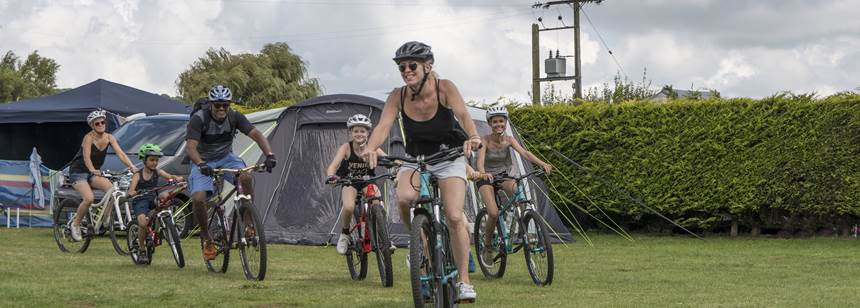 Family bike ride on adgestone campsite