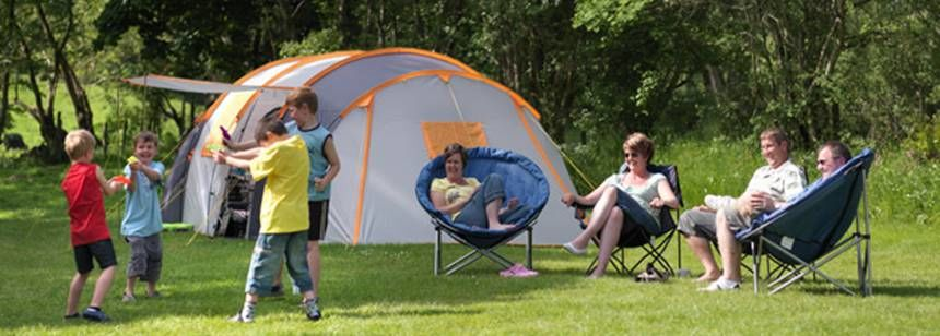 Families Relaxing by Their Tent at Bala Camp Site, Gwynedd