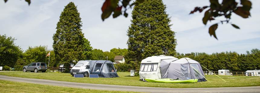 Motorhome and Caravan pitched up on California Cross Campsite