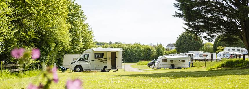 Motorhomes and Caravans pitched up on California Cross Campsite
