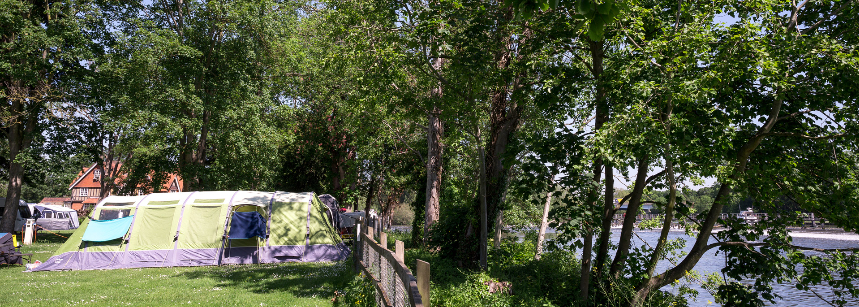 Kids playing on swings at Chertsey Camping and Caravanning Club Site
