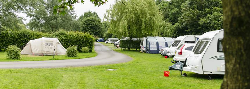 caravns and tents pitched up on Devizes Club Site