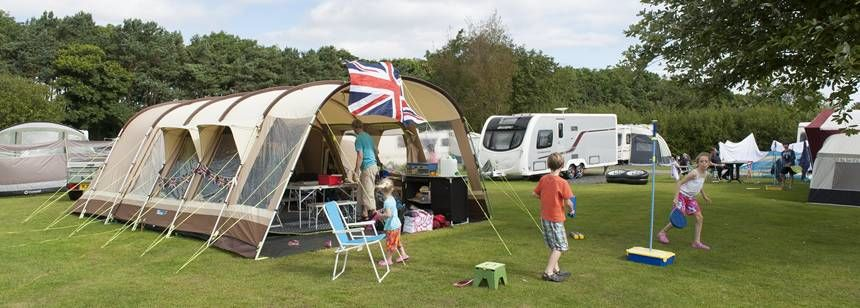 A Family Relaxing and Enjoying Each Other Companies at Dunstan Hill Camp Site, Northumberland