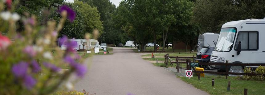 Motorhomes and caravans pitched up on Hertford campsite