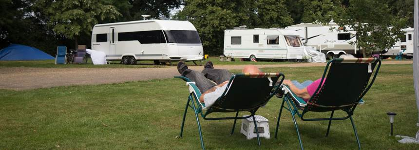 Couple relaxing on Hertford campsite