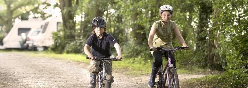 Kids Enjoying the Cycle Paths in Kelvedon Hatch Camp Site, Essex