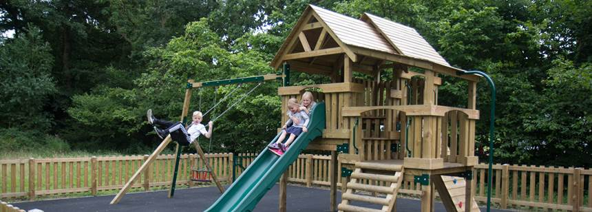 Children Enjoying the Play Area and Facilities at Kelvedon Hatch Camp Site, Essex