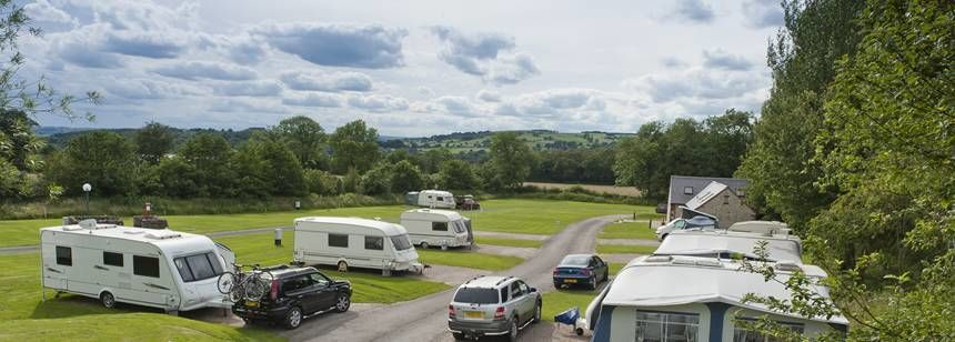 Grass and Hard Standing Pitches Surrounded by the Woods at Leek Camp Site, Staffordshire
