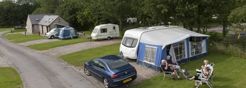 A Couple Relaxing and Enjoying the Peace and Quiet at Leek Camp Site, Staffordshire