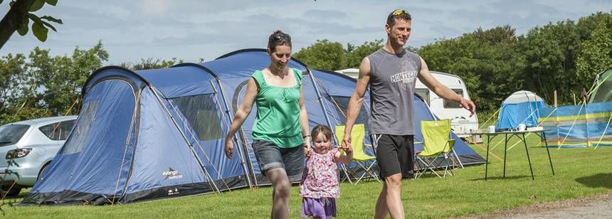 Family walking through Lynton campsite