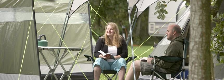 A Couple Relaxing and Enjoying the Peace and Quite of the Moreton Camp Site, Dorset