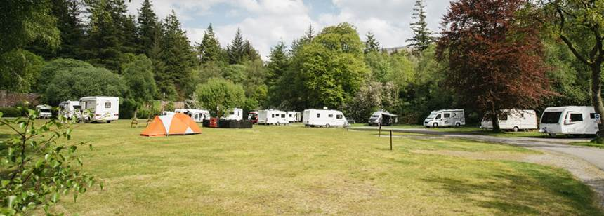Grass Pitches and Kids Playing and Enjoying Their Time at the Oban Camp Site, Argyll