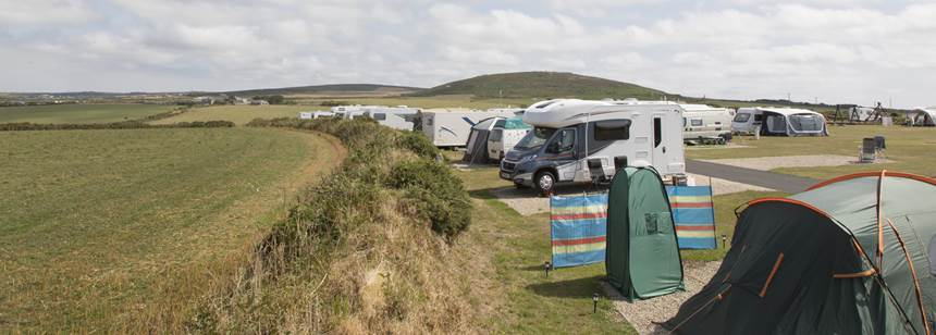 Motorhomes and tents pitched on Sennen Cove Campsite