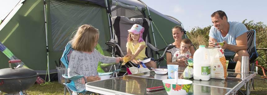 Family enjoying meal on Sennen Cove Campsite