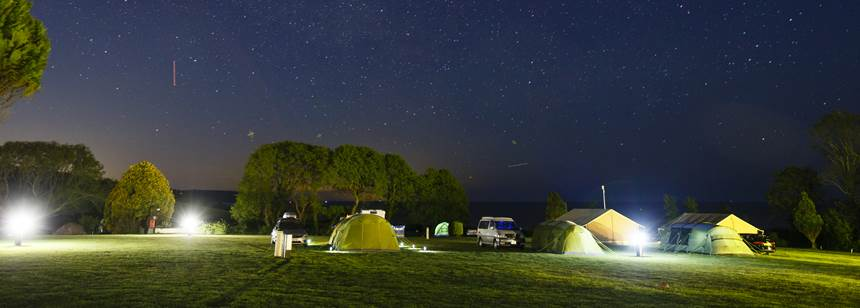 A Family Camping in the Picturesque Surrounds of the Slapton Sands Camp Site, Devon