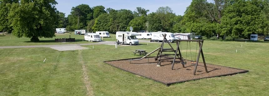 A Children's Play Area Surrounded by Grass Pitches at the Theobalds Park Camp Site, Hertfordshire